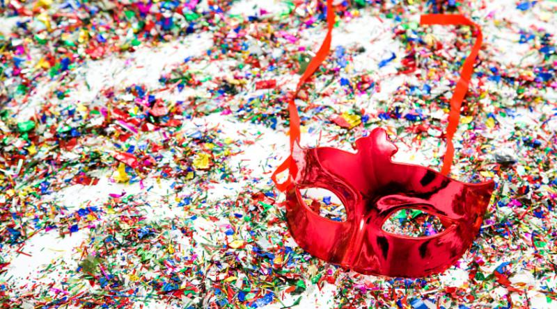 Carnival background with confetti and mask